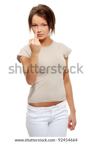 Angry young woman making obscene hand gesture by showing middle finger on white background - stock photo