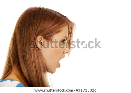 Angry young woman screaming for someone - stock photo