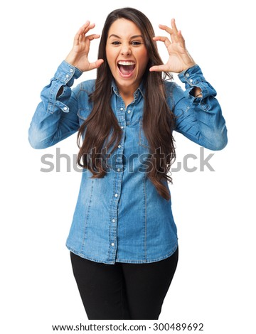 angry young woman shouting - stock photo