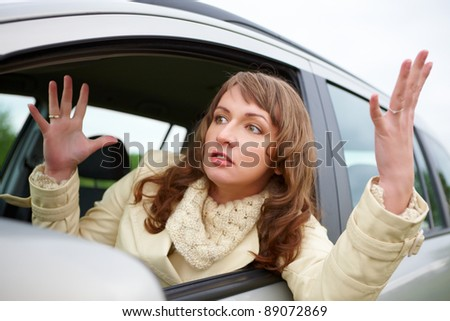 Angry young woman stuck in a traffic jam - stock photo