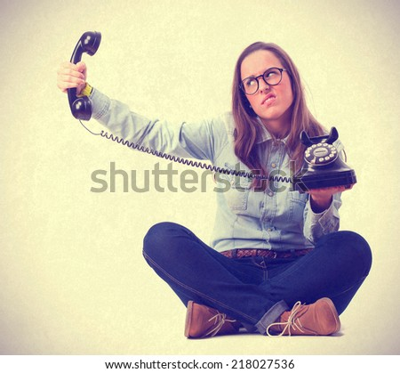 angry young woman with a phone - stock photo
