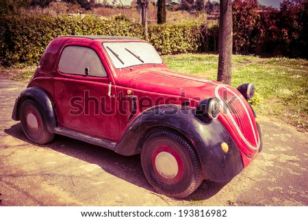 ANGUILLARA SABAZIA, LAZIO, ITALY - APRIL 6, 2014: Model of the old Fiat 500 Topolino. The name Topolino translates literally as little mouse in Italian, but is also the Italian name for Mickey Mouse. - stock photo