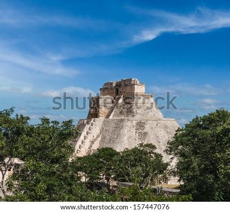 Anicent mayan pyramid (Pyramid of the Magician, Adivino) in Uxmal, M���©rida, Yucat���¡n, Mexico - stock photo