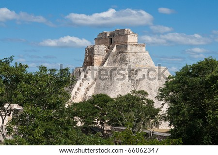 Anicent mayan pyramid (Pyramid of the Magician, Adivino  ) in Uxmal, Mexico - stock photo