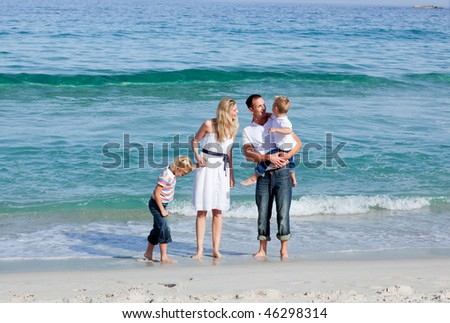 Animated family walking on the sand at the beach - stock photo