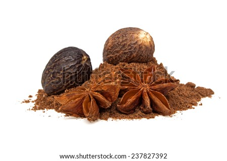 Anise and nutmeg with its powder on a white background - stock photo