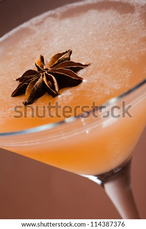 Anise cocktail detail on brown background - stock photo