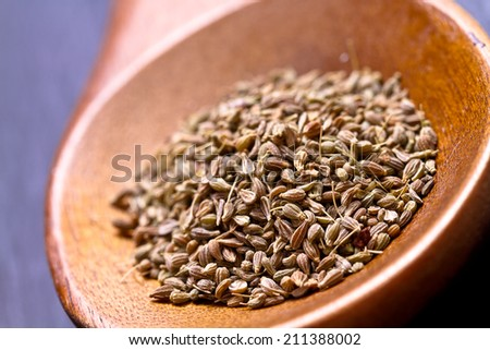 Anise seeds on wooden spoon  - stock photo