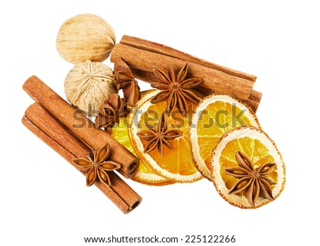 anise star, cinnamon sticks, walnut and dried orange isolated on white background, christmas spices - stock photo