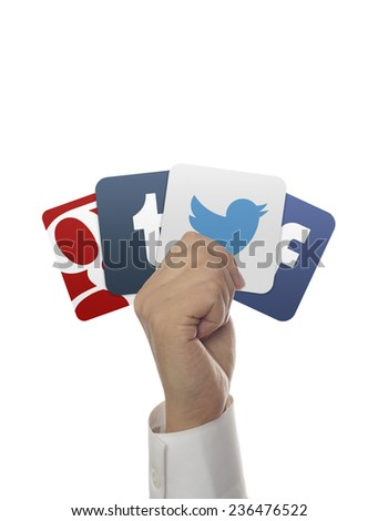 Ankara, TURKEY, Aug 04, 2012. Facebook, google plus, twitter, tumblr app icons in hand. Hand holding popular social media icons. - stock photo