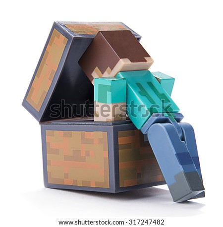 Ankara, Turkey  July 01, 2015: Minecraft figure Herobrine checking inside of a chest isolated on white background.  Minecraft is a game about breaking and placing blocks.  - stock photo