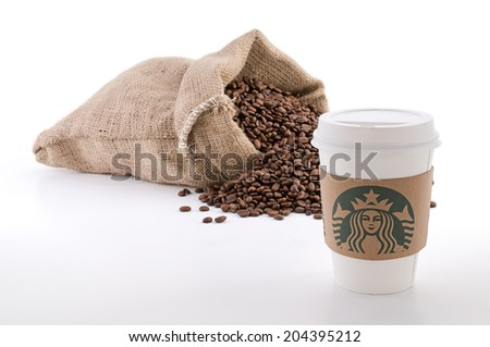 Ankara, Turkey - June 07, 2012:  A Starbucks coffee cup with new designed cup sleeve.  - stock photo