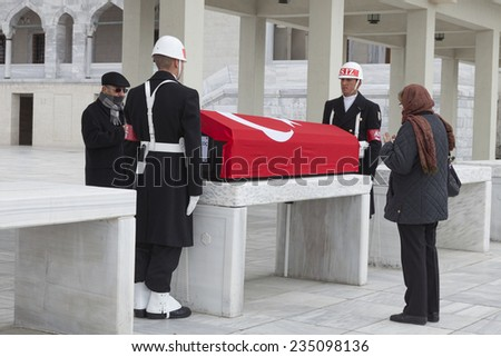 ANKARA, TURKEY-MARCH 24, 2013: Two Turkish soldiers are on honor guard for the funeral of a retired military personnel outside the iconic Kocatepe Mosque in Turkish capital Ankara. - stock photo