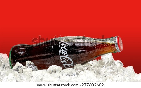 ANKARA - TURKEY - May 10, 2015 Editorial photo of 250ml Classic Coca-Cola bottle with ice on red background. Coca-Cola Company is the most popular market leader in Turkey. - stock photo