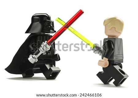 Ankara, Turkey - May 27, 2014: Lego Star Wars minifigure Darth Vader and Luke Skywalker are fighting with sword isolated on white background.   - stock photo