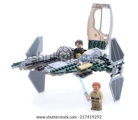 Ankara, Turkey - May 23, 2013: Lego Starwars Anakin's Jedi Interceptor with Anakin Skywalker, Obi-Wan Kenobi, security battle droid and R2-D2 minifigures isolated on white background. - stock photo