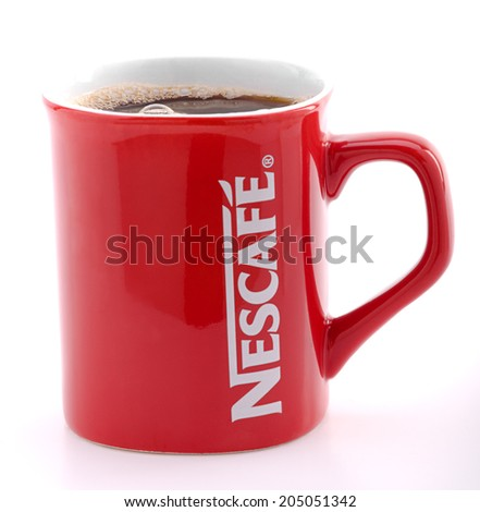 Ankara, Turkey - May 31, 2012: Studio shot of a red Nescafe cup isolated on white background.   - stock photo