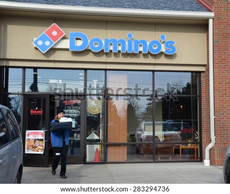 ANN ARBOR, MI - DECEMBER 22: Domino's, whose north Ann Arbor store is shown on December 22, 2014, has over 11,000 locations.  - stock photo