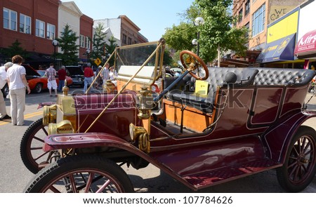 ANN ARBOR, MI - JULY 13: 1912 Ford Model T at the Rolling Sculpture car show July 13, 2012 in Ann Arbor, MI. - stock photo