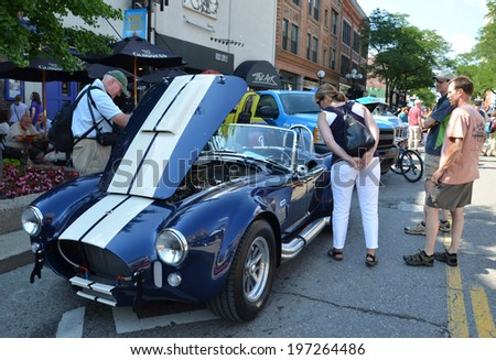 ANN ARBOR, MI - JULY 12: 1965 Shelby Cobra at the Rolling Sculpture car show  July 12, 2013 in Ann Arbor, MI - stock photo