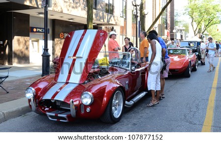 ANN ARBOR, MI - JULY 13: 1966 Tribute Shelby AC Cobra at the Rolling Sculpture car show July 13, 2012 in Ann Arbor, MI. - stock photo