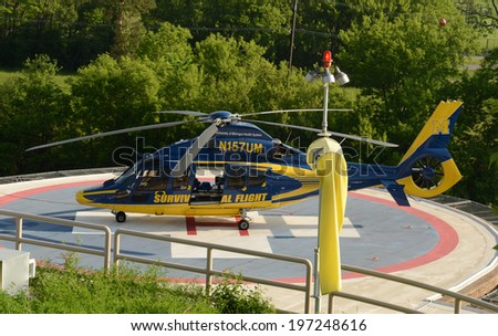 ANN ARBOR, MI - JUNE 3: A University of Michigan Survival Flight helicopter sits at its helipad on June 3, 2014 in Ann Arbor, MI.  Survival flight has transported over 57,000 patients over 30 years.   - stock photo
