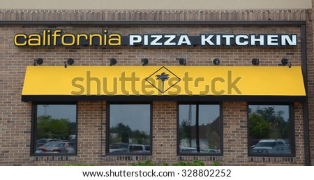ANN ARBOR, MI - JUNE 7: California Pizza Kitchen, whose Ann Arbor store logo and awning are shown on June 7, 2015, has over 200 stores.  - stock photo
