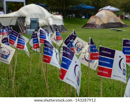 ANN ARBOR, MI - JUNE 22: Flags and participant tents at the Relay for Life of Ann Arbor event on June 22, 2013 in Ann Arbor, MI.