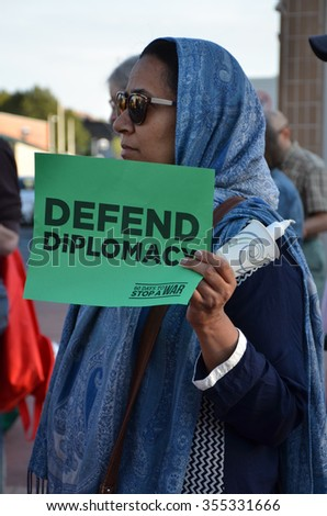 ANN ARBOR, MI - SEPTEMBER 10:  A protester holds up a sign at a peace rally in Ann Arbor, MI on September 10, 2015.