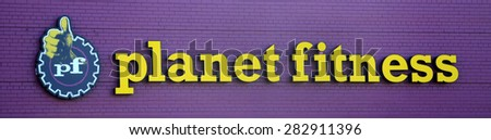 ANN ARBOR, MI - SEPTEMBER 7:  Planet Fitness, whose west Ann Arbor, MI location logo is shown on September 7, 2014, has over 900 locations.  - stock photo