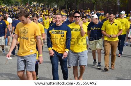 ANN ARBOR, MI - SEPTEMBER 26: University of Michigan football fans enter the stadium before the BYU game on September 26, 2015. Michigan lost the game 0-31. - stock photo