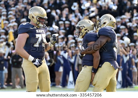 ANNAPOLIS, MD - OCTOBER 31: Navy Midshipmen fullback Chris Swain (37) congratulate teammate Keenan Reynolds on a TD carry  during the AAC game October 31, 2015 in Annapolis, MD.  - stock photo