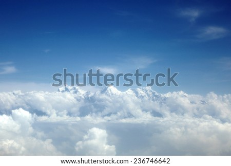 Annapurna and machhapuchhre range in the mid of clouds - stock photo