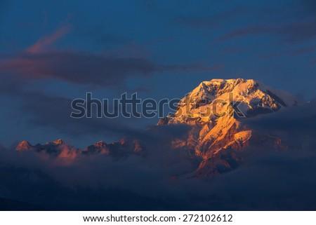 Annapurna I Himalaya Mountains in Nepal at sunrise - stock photo