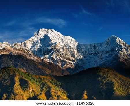 Annapurna South at sunrise, Nepal - stock photo
