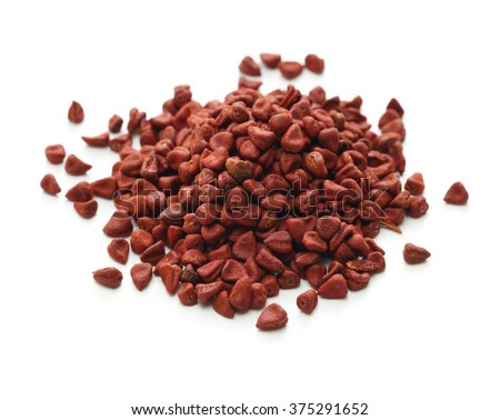 annatto seeds, achiote seeds, bixa orellana seeds - stock photo