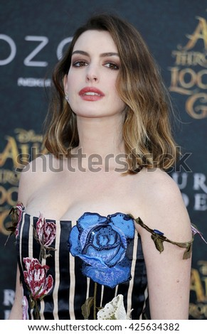 Anne Hathaway at the Los Angeles premiere of 'Alice Through The Looking Glass' held at the El Capitan Theater in Hollywood, USA on May 23, 2016. - stock photo