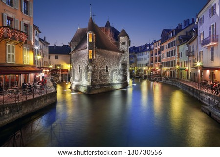 Annecy, France. The old prison in Annecy, the Palais de l'isle, at dusk. - stock photo