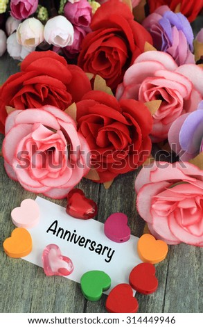 anniversary message with roses and hearts - stock photo