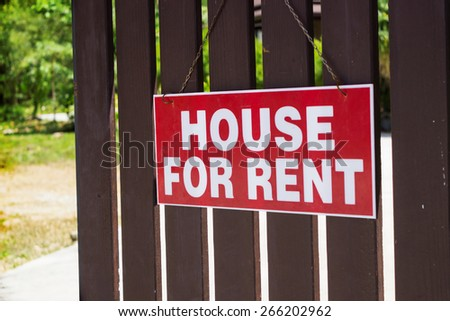 Announcement for rent house hanging on the fence - stock photo