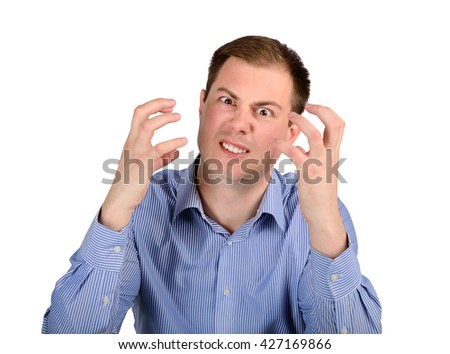 Annoyed and angry business man. The concept of emotions and feelings - stock photo