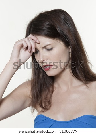 annoyed beautiful expressive woman on isolated white background