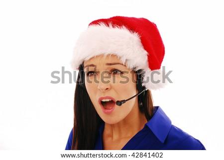 Annoyed customer service operator wearing santa hat on white background - stock photo