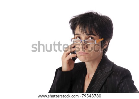 Annoyed female business woman looking over her glasses. isolated on white background