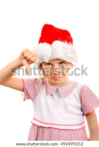Annoyed Small Girl in Santa Hat make Thumb Down on the White Background
