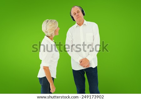 Annoyed woman being ignored by her partner against green vignette - stock photo