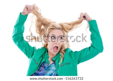 Annoyed woman tearing her hair - stock photo