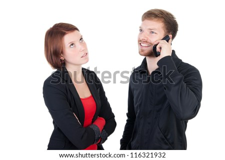 Annoyed woman waiting for the phone - stock photo
