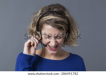 annoyed young female professional working for a customer service with headset - stock photo