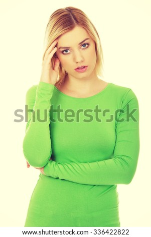 Annoyed young woman holding her head. - stock photo
